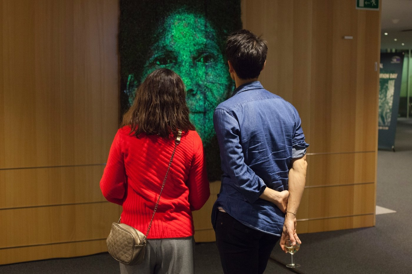 Couple looking at art piece from the exhibition against the the destruction of the Amazon